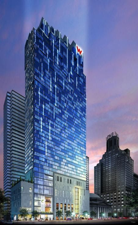 The exterior of the W Hotel and Element by Westin in Philadelphia. The facade is glass and the roof is geometric.