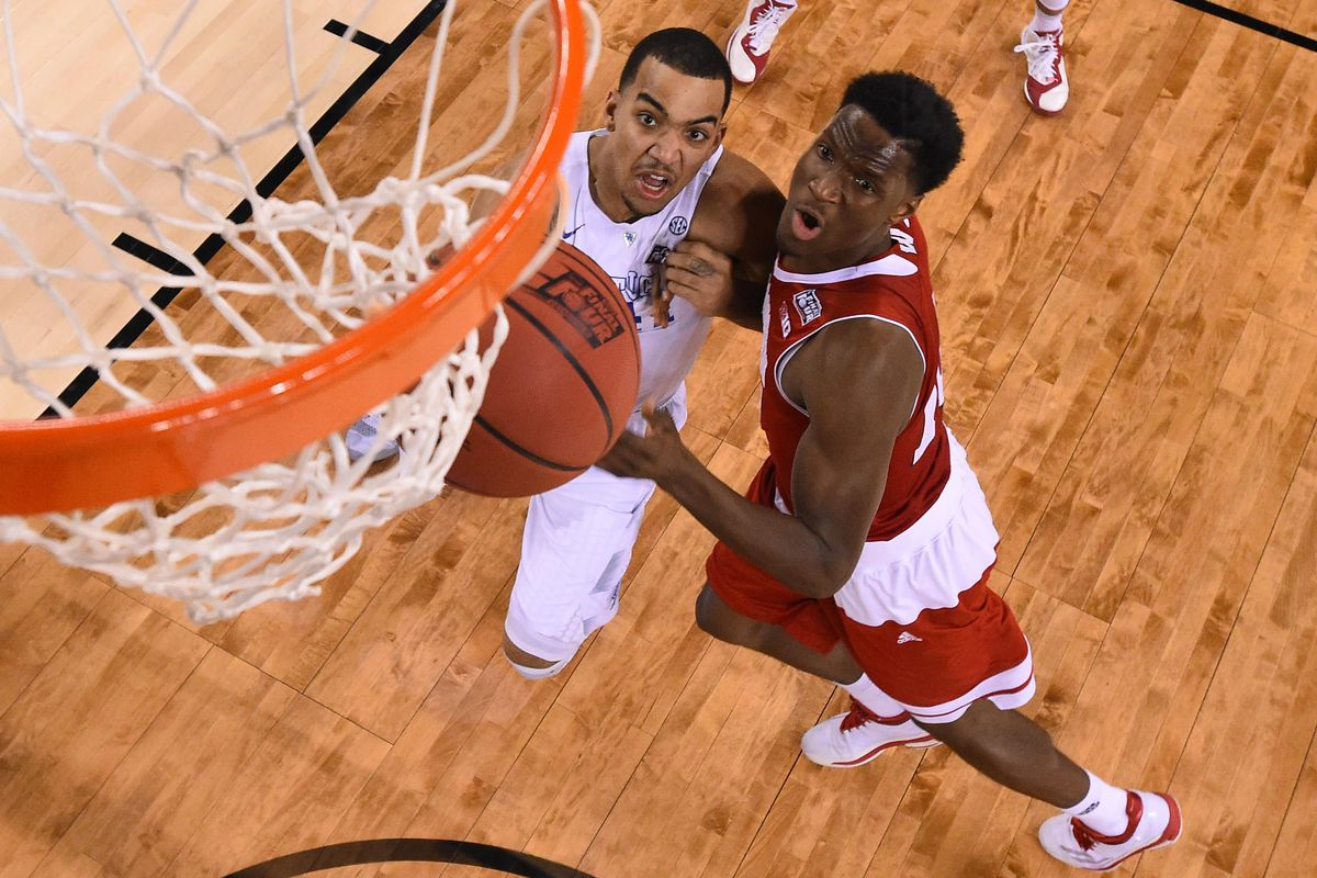 Trey Lyles competes with Nigel Hayes for a rebound in the NCAA National Championship.