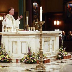 The Most Reverend John C. Wester officiates in Easter Mass at the Cathedral of the Madeleine Sunday, April 8, 2012 in Salt Lake City.
