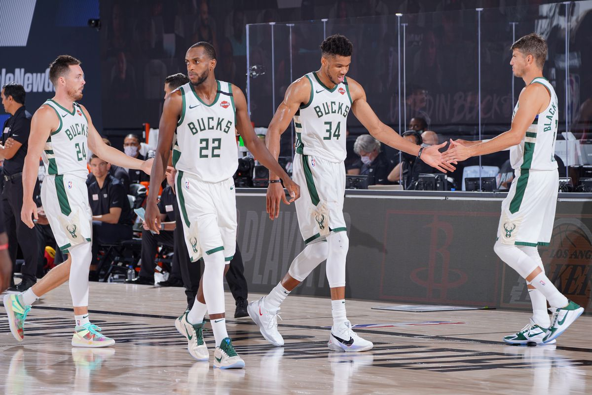 Giannis Antetokounmpo #34 of the Milwaukee Bucks high-fives teammates during Game Four of the Eastern Conference SemiFinals of the NBA Playoffs on September 6, 2020 at AdventHealth Arena in Orlando, Florida.