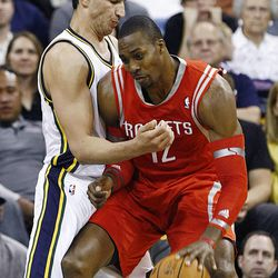 Utah Jazz's center Enes Kanter (0) works to defend Houston s Dwight Howard as the Jazz and the Rockets play Saturday, Nov. 2, 2013 in EnergySolutions arena.