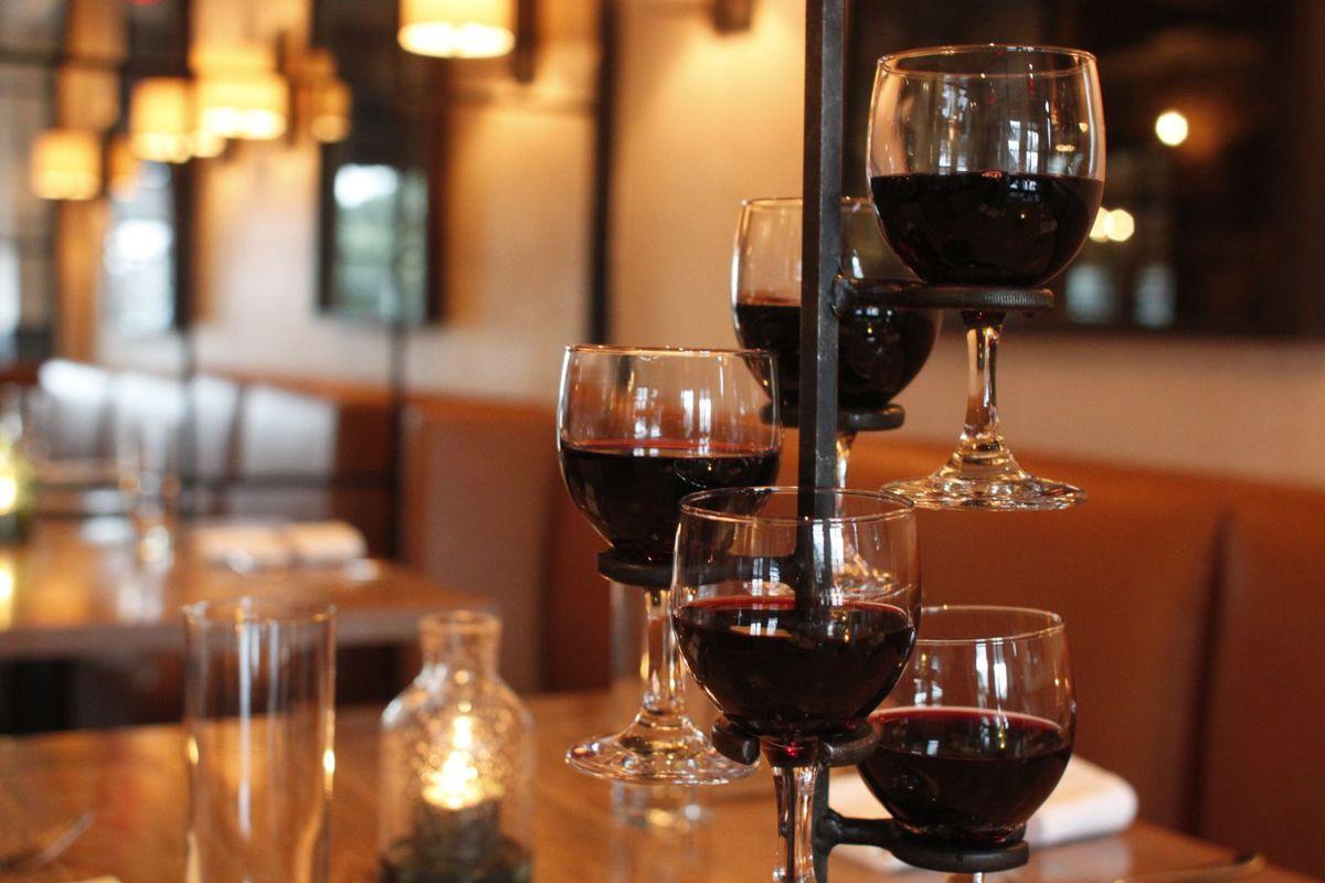 filled wine glasses in a holder