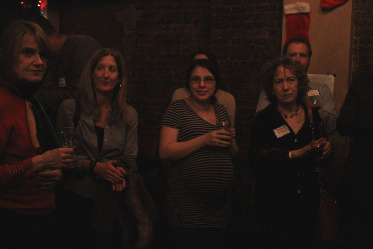 Chalkbeat Managing Editor Philissa Cramer (center) and readers gather at Chalkbeat New York's holiday celebration.