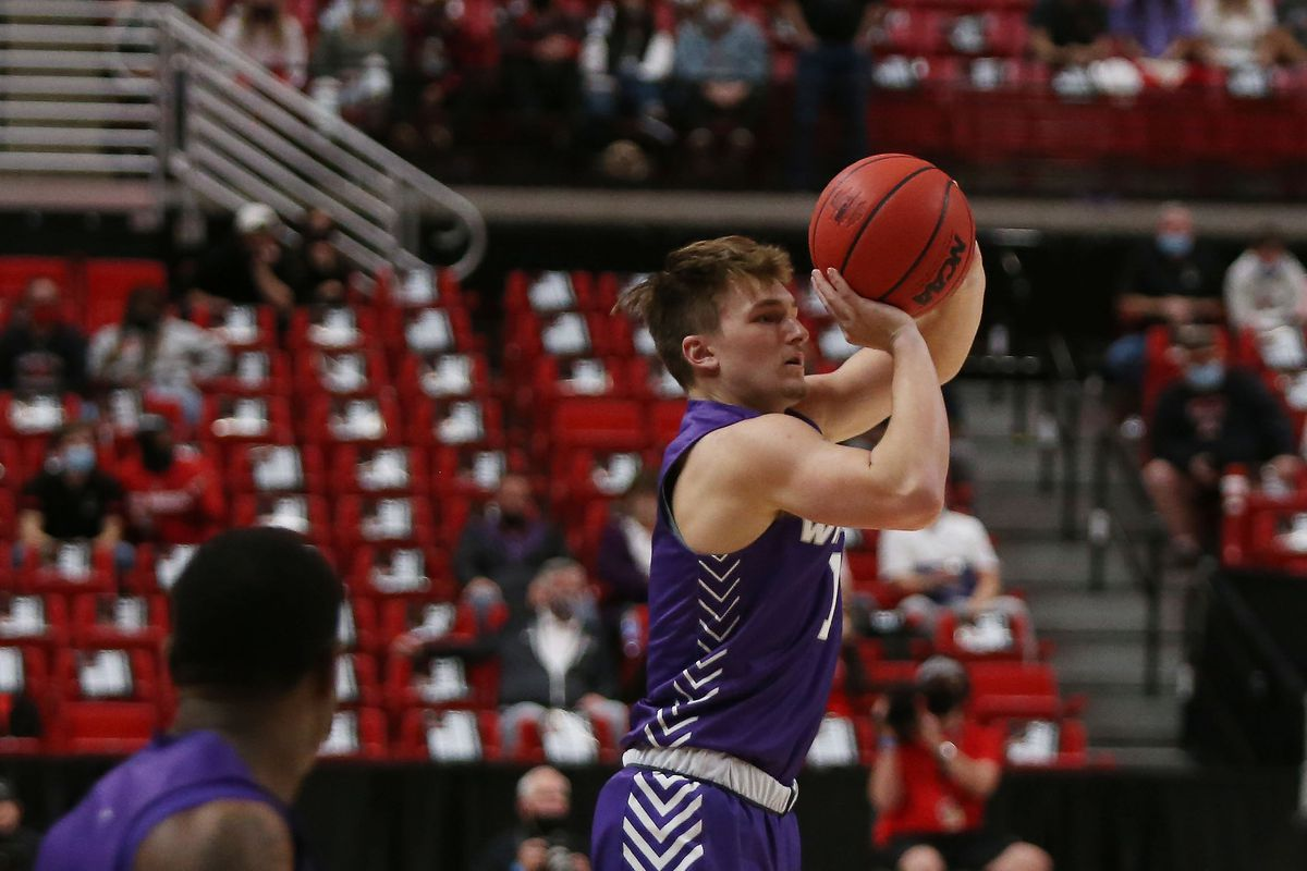 Abilene Christian Wildcats guard Reggie Miller takes a jump shot against the Texas Tech Red Raiders in the second half at United Supermarkets Arena.