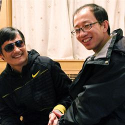 Blind Chinese legal activist Chen Guangcheng, left, an inspirational figure in China's rights movement, meets with Hu Jia at an undisclosed location after escaping.