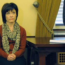 Utah Attorney General John Swallow's wife. Suzanne, listens as her husband announces his resignation during a press conference at the Capitol in Salt Lake City on Thursday, Nov. 21, 2013.