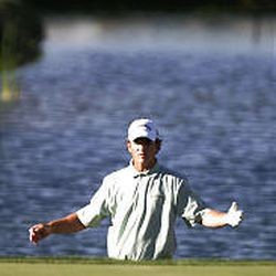 Brian Henninger, who hit his ball into the water on the 18th hole, surveys the situation. He was one of three players who tied for second.