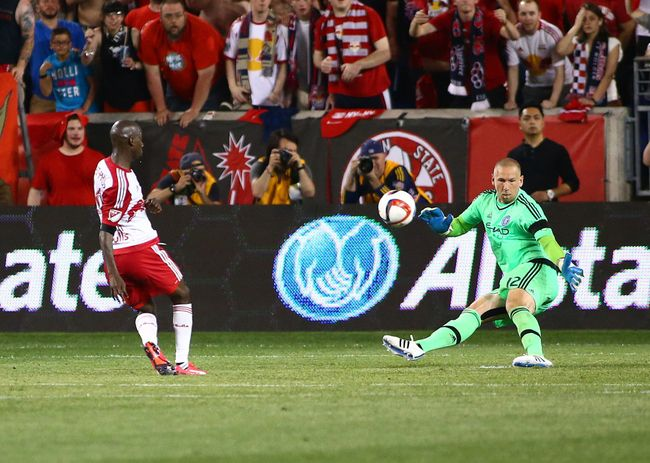 May 10, 2015; Harrison, NJ, USA; New York City FC goalkeeper Josh Saunders (12) makes a save on a close in shot by New York Red Bulls forward Bradley Wright-Phillips (99) during the second half at Red Bull Arena. The Red Bulls defeated NYCFC 2-1. Mandatory Credit: Andy Marlin-USA TODAY Sports