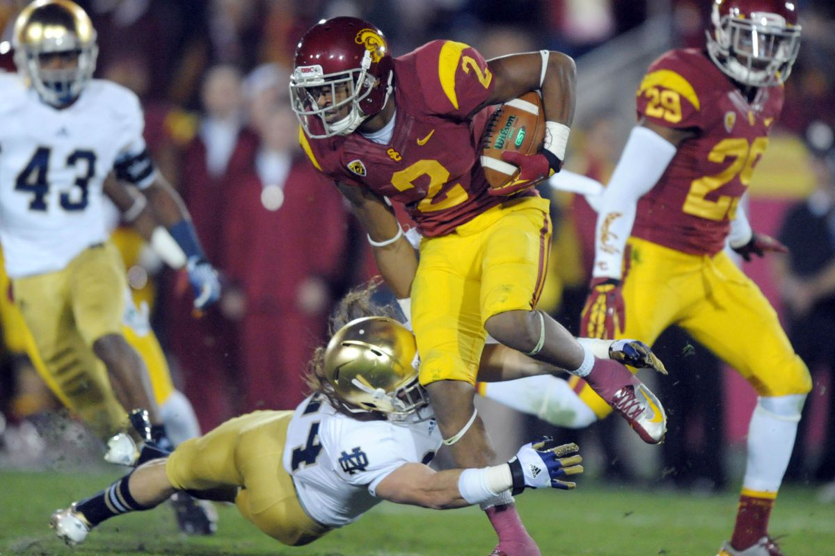 The Cougars will play USC next year. Robert Woods probably won't be there.