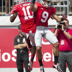 Ohio State Buckeyes wide receivers Devin Smith (9) and Philly Brown (10) celebrate Smith's touchdown against the Buffalo Bulls at Ohio Stadium.