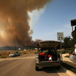 Pam Jepperson is evacuated from her home at the Lodge at Stillwater near the Jordanelle Reservoir on Saturday, Aug. 18, 2012.