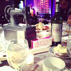 Each table setting featured a sewing machine centerpiece and a bevy of Lacoste fragrances.