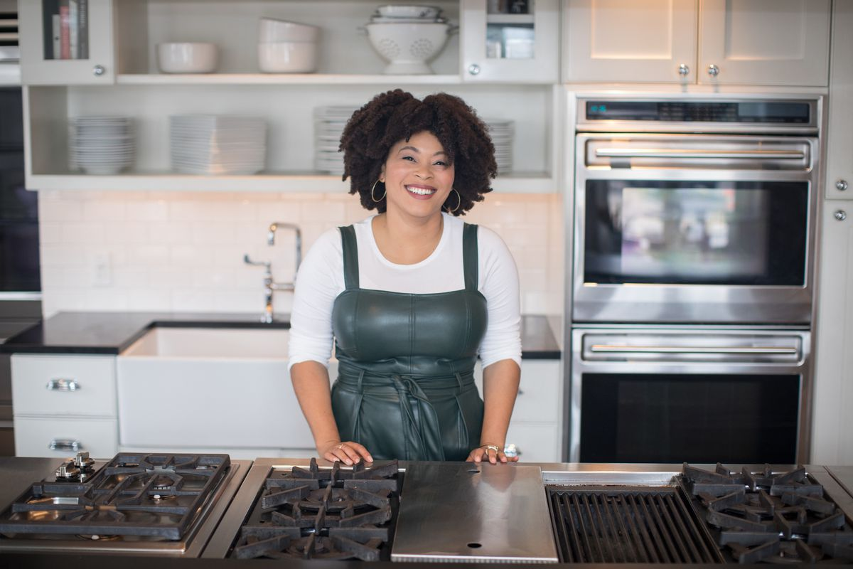Woman smiling in a kitchen.