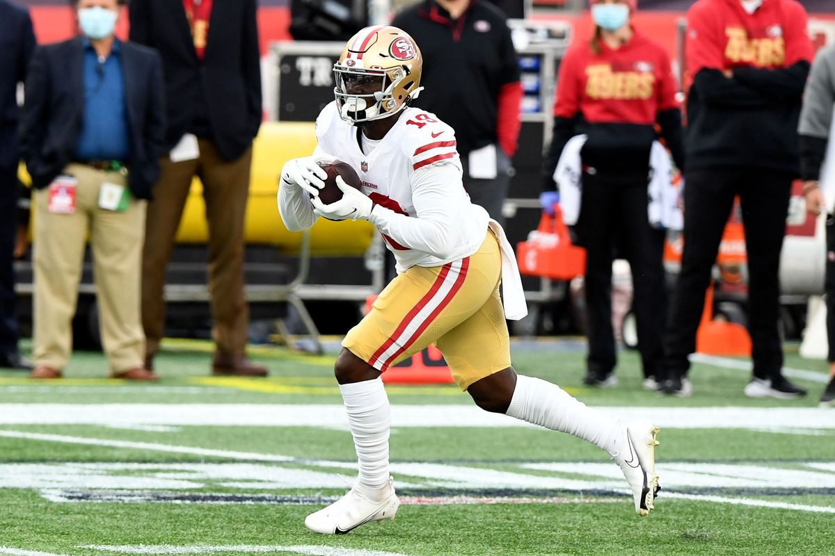 San Francisco 49ers wide receiver Deebo Samuel runs with the ball against the New England Patriots during the first half at Gillette Stadium.
