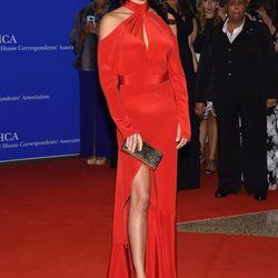 Adriana Lima wears a Juan Carlos Obando gown and carries a Nancy Gonzalez clutch.