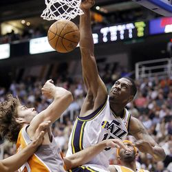 Utah Jazz forward Derrick Favors (15) dunks over Phoenix Suns center Robin Lopez (15) as the Utah Jazz and the Phoenix Suns play Tuesday, April 24, 2012 in Energy Solutions arena.