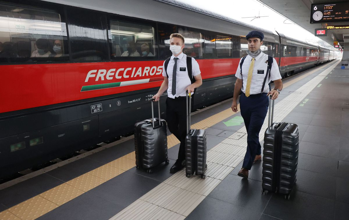 Elder Samuel Nagliati, a missionary for The Church of Jesus Christ of Latter-day Saints, right, picks up his new companion, Elder Nathan Gregory, at the train station in Bologna, Italy, on Thursday, Sept. 16, 2021.