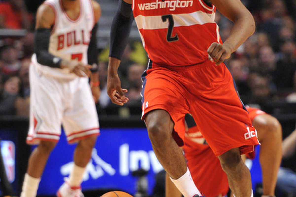 April 16, 2012; Chicago, IL, USA; Washington Wizards point guard John Wall (2) chases a loose ball against the Chicago Bulls during the second quarter at the United Center.  Mandatory Credit: Rob Grabowski-US PRESSWIRE
