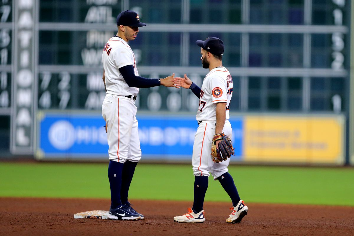 Houston Astros shortstop Carlos Correa and second baseman Jose Altuve celebrate after defeating the Los Angeles Angels at Minute Maid Park.