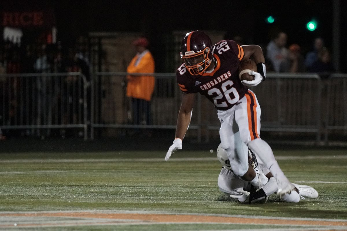 Brother Rice's Willie Shaw (26) steps out of a tackle.