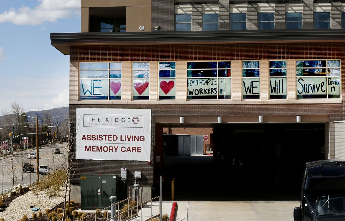 A sign thanking health care workers is displayed in the windows at The Ridge Foothill, a retirement community in Salt Lake City, on Thursday, April 2, 2020.
