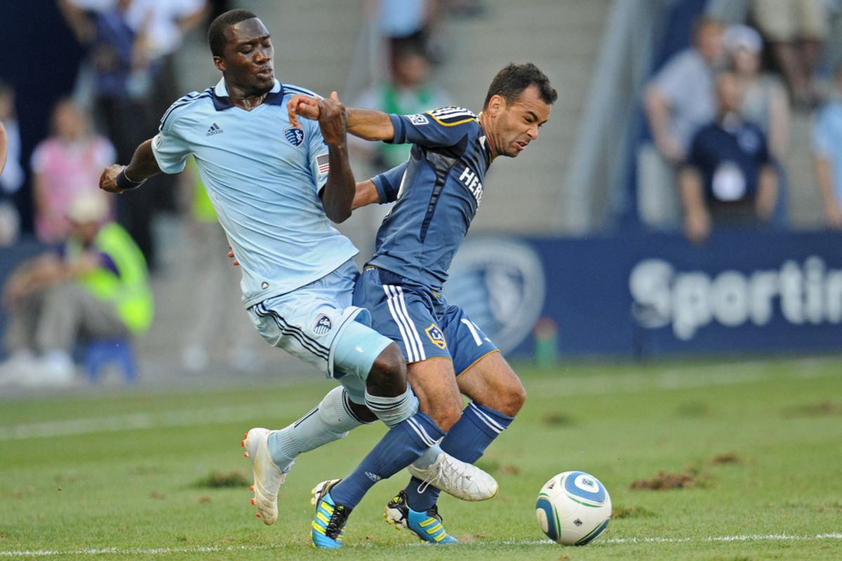The April 7th match between Sporting KC and the LA Galaxy won't include  Juninho (right), who returned to Brazil after the end of the 2011 season.  (Photo by Peter Aiken/Getty Images)