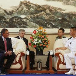 U.S. Defense Secretary Leon Panetta, left, meets with the Commander of the North Sea Fleet Vice Adm. Tian Zhong, right, at Qingdao, China before touring Chinese naval vessels, Thursday, Sept. 20, 2012. Panetta is getting a rare glimpse inside the Chinese naval base and will be touring two of its ships.