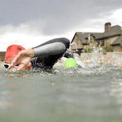 John Karren trains for a swim marathon at a small lake in Herriman on Aug. 4.