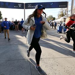 Fans run to find their seats after having their tickets scanned as BYU and Utah play an NCAA football game at LaVell Edwards Stadium in Provo on Saturday, Sept. 11, 2021.