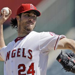 Los Angeles Angels starter Dan Haren pitches to the Seattle Mariners in the second inning of a baseball game in Anaheim, Calif., Thursday, Sept. 27, 2012.