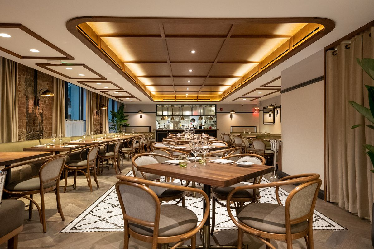 The interior of the restaurant Francie with a long view of the establishment featuring tables and chairs.