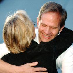 Ed Smart hugs a family friends after Elizabeth Smart was found March 12, 2003.