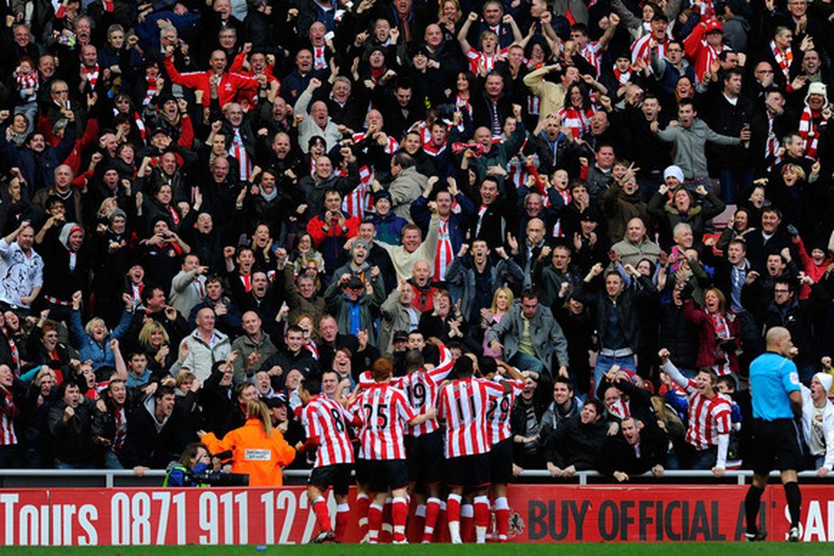SUNDERLAND ENGLAND - JANUARY 16: Sunderland fans celebrate their goal during the Barclays Premier League match between Sunderland and Newcastle United at Stadium of Light on January 16 2011 in Sunderland England.  (Photo by Stu Forster/Getty Images)