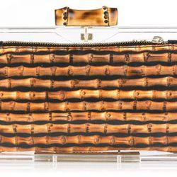 "<b>Charlotte Olympia</b> Pandora perspex clutch box in bamboo print, <a href=""http://www.charlotteolympia.com/pandora-2953.html#"">$895</a>"