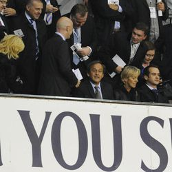 UEFA President Michel Platini, center, of France, sits to watch a Europa League Group J soccer match between Lazio and Tottenham Hotspur's at White Hart Lane ground in London, Thursday, Sept. 20, 2012.