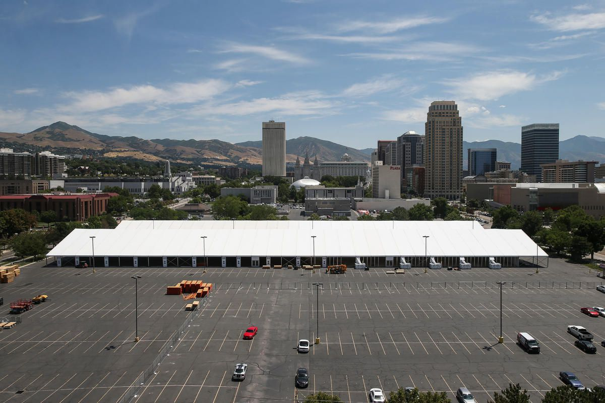 Crews set up temporary exhibit space for the upcoming Outdoor Retailer show across from the main venue, the Salt Palace Convention Center, in Salt Lake City on Thursday, July 6, 2017.