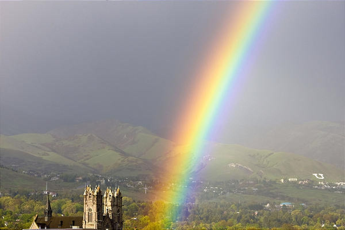 A rainbow rises on May 10 near the Cathedral of the Madeleine, with the east bench of Salt Lake City in the background.