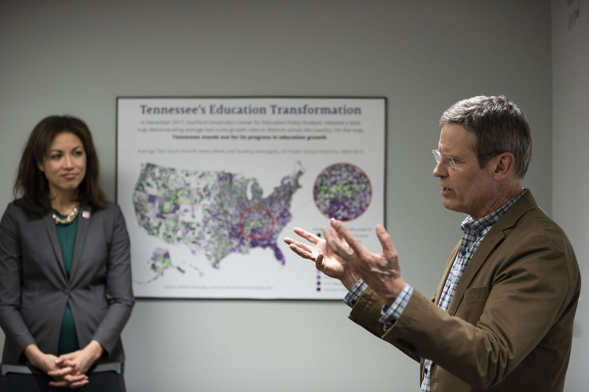 Tennessee Education Commissioner Penny Schwinn listens to Gov. Bill Lee during a March visit to state Education Department offices in Nashville.