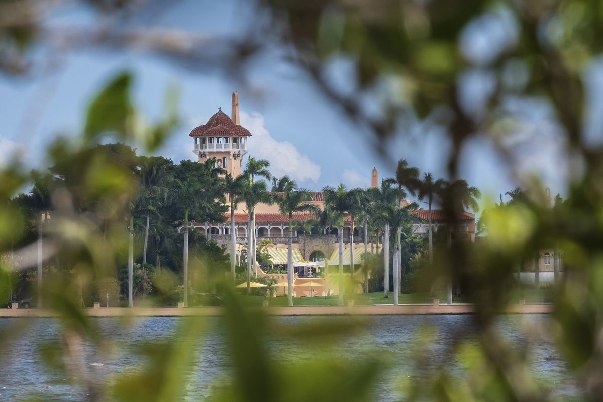 FILE - This Nov. 23, 2018 file photo shows President Donald Trump's Mar-a-Lago estate behind mangrove trees in Palm Beach, Fla. On Saturday, March 30, 2019, a woman carrying two Chinese passports and a device containing computer malware lied to Secret Ser