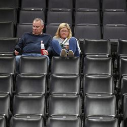 Basketball fans sit in an empty section after it is announced that an NBA basketball game between Oklahoma City Thunder and Utah Jazz in Oklahoma City has been postponed, Wednesday, March 11, 2020.