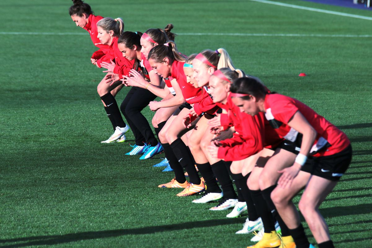 The Thorns goes through pre-game routines prior to their preseason match against the University of Portland on March 21, 2015.