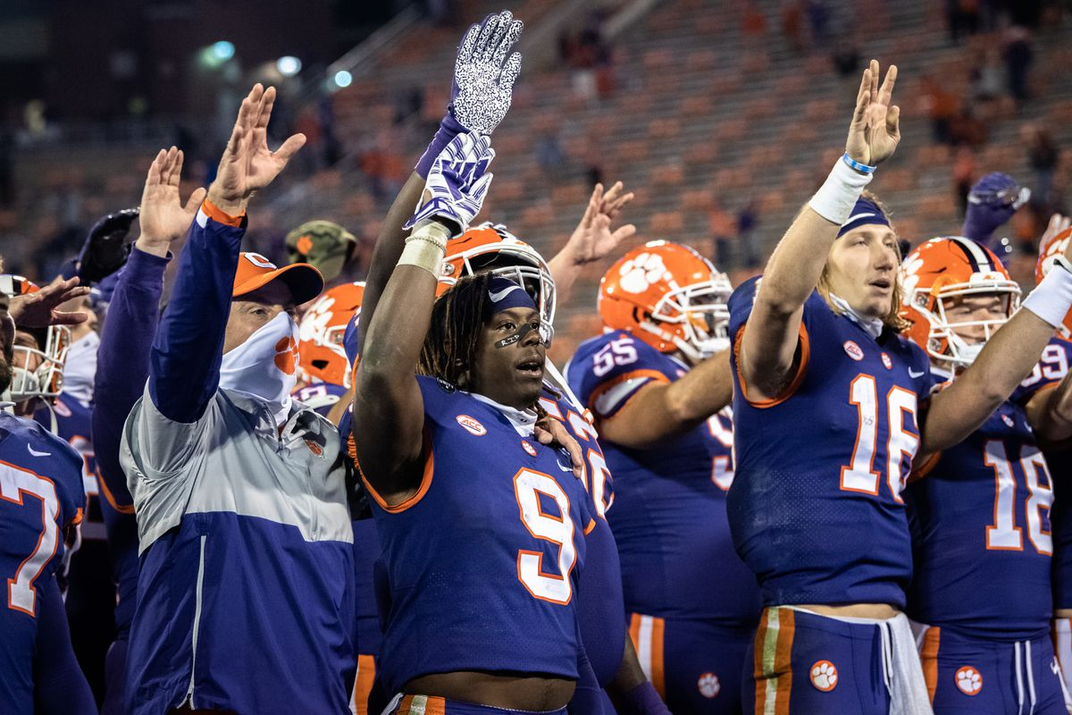 Clemson running back Travis Etienne and Clemson quarterback Trevor Lawrence wave after defeating Pittsburgh 52-17 in their last home game with the team at Memorial Stadium.
