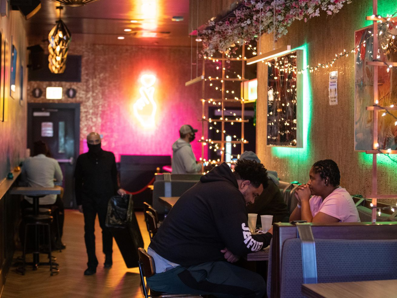 People eat in Miki's Park in River North last month. Indoor capacity is expanding to the lesser of 50% or 100 people per room at establishments across the city and suburbs.