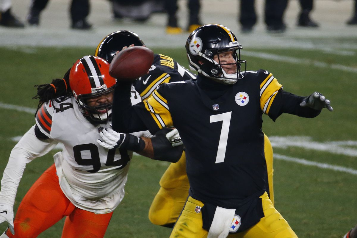 Ben Roethlisberger #7 of the Pittsburgh Steelers in action against Adrian Clayborn #94 of the Cleveland Browns on January 11, 2021 at Heinz Field in Pittsburgh, Pennsylvania.