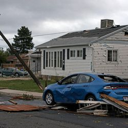 Vehicles and homes sustained damage after a tornado struck Washington Terrace on Thursday, Sept. 22, 2016. Officials said nobody was injured in the twister.
