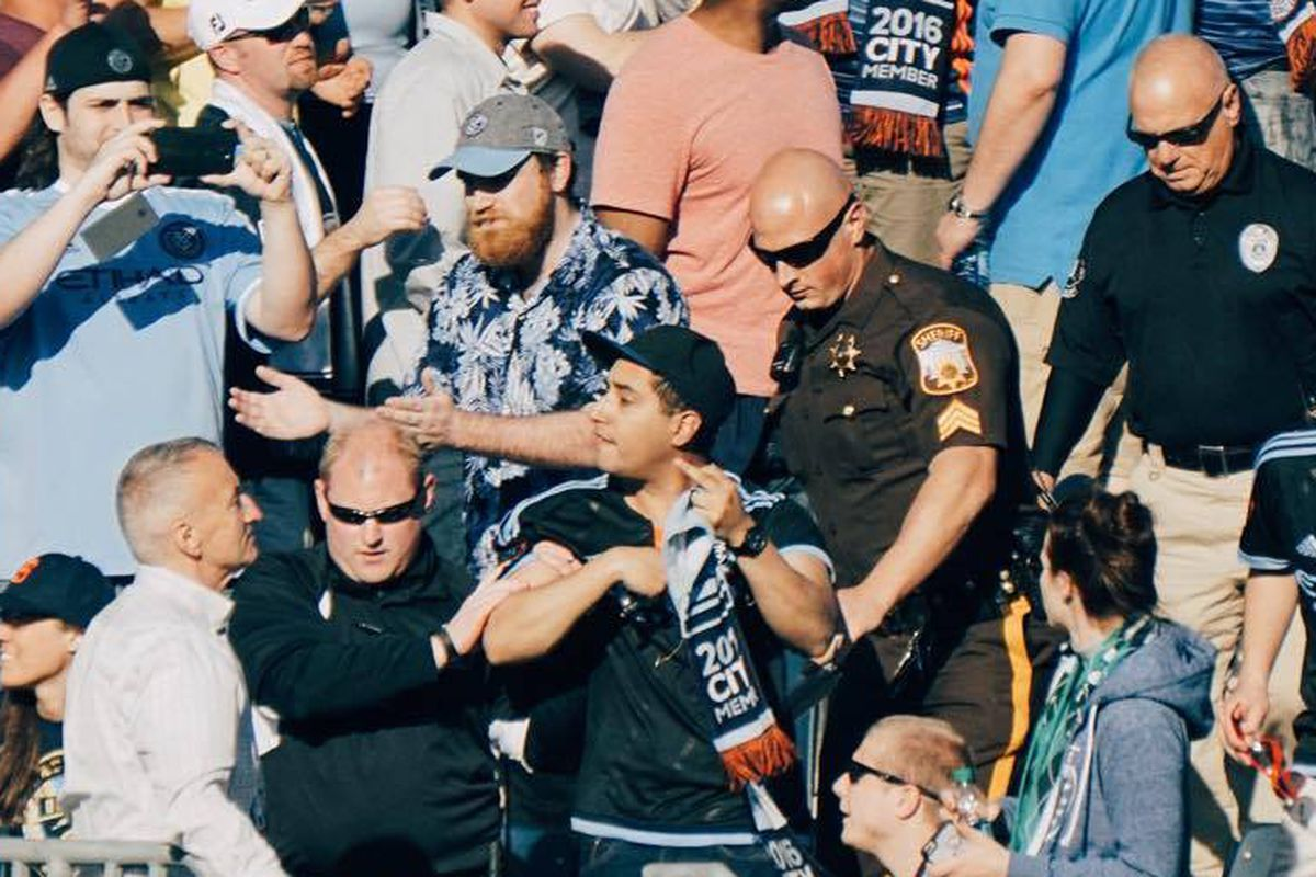 New York City FC fan being escorted out of the match against the Philadelphia Union.
