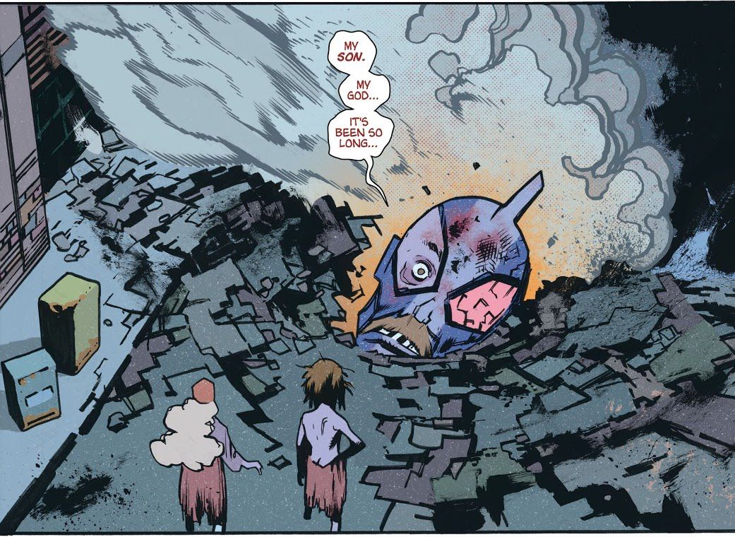 """The huge severed head of an Ultraman-style kaiju warrior — his dad-style mustache is visible despite the costume — lies in a crater in a city street as two raggedly-dressed, normal sized people look on. """"My son,"""" says the head. """"My god... it's been so long,"""" in Ultramega #4 (2021)."""
