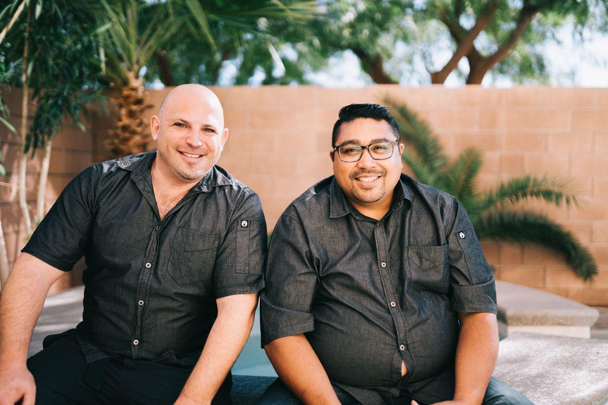Two men in black shirts