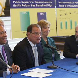 Massachusetts Gov. Deval Patrick, left, sits on a panel with, from left, former President of the Massachusetts Senate Robert Travaglini, President of the Massachusetts Medical Society Dr. Lynda Young and President and CEO of Blue Cross Blue Shield of Massachusetts Andrew Dreyfus at Faneuil Hall in Boston, Wednesday, April 11, 2012. Gov. Patrick and the other participants were celebrating the sixth anniversary of Massachusetts' landmark health care law that was signed by former Gov. Mitt Romney at Faneuil Hall in 2006.
