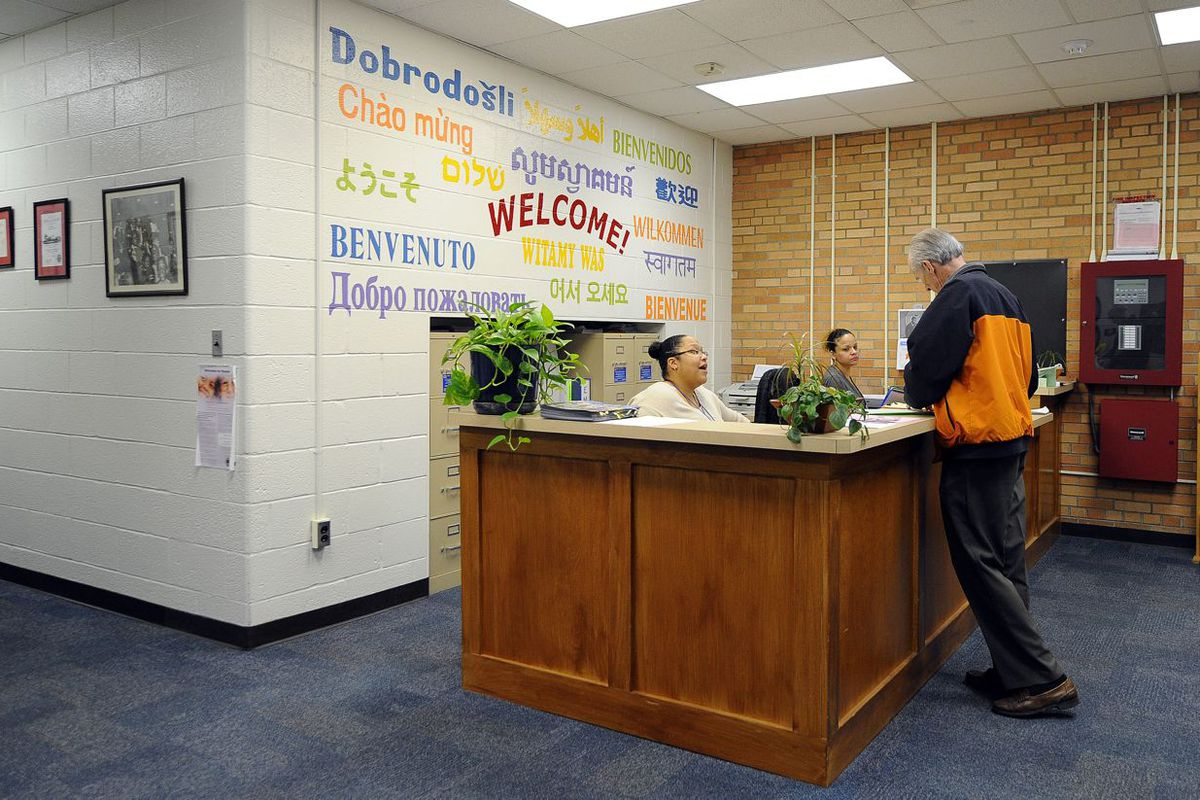 The front desk at School 27, a Center For Inquiry magnet school, welcomes students in several languages. CFI schools can cost more because they use specialized curriculum and teachers trained to use it.